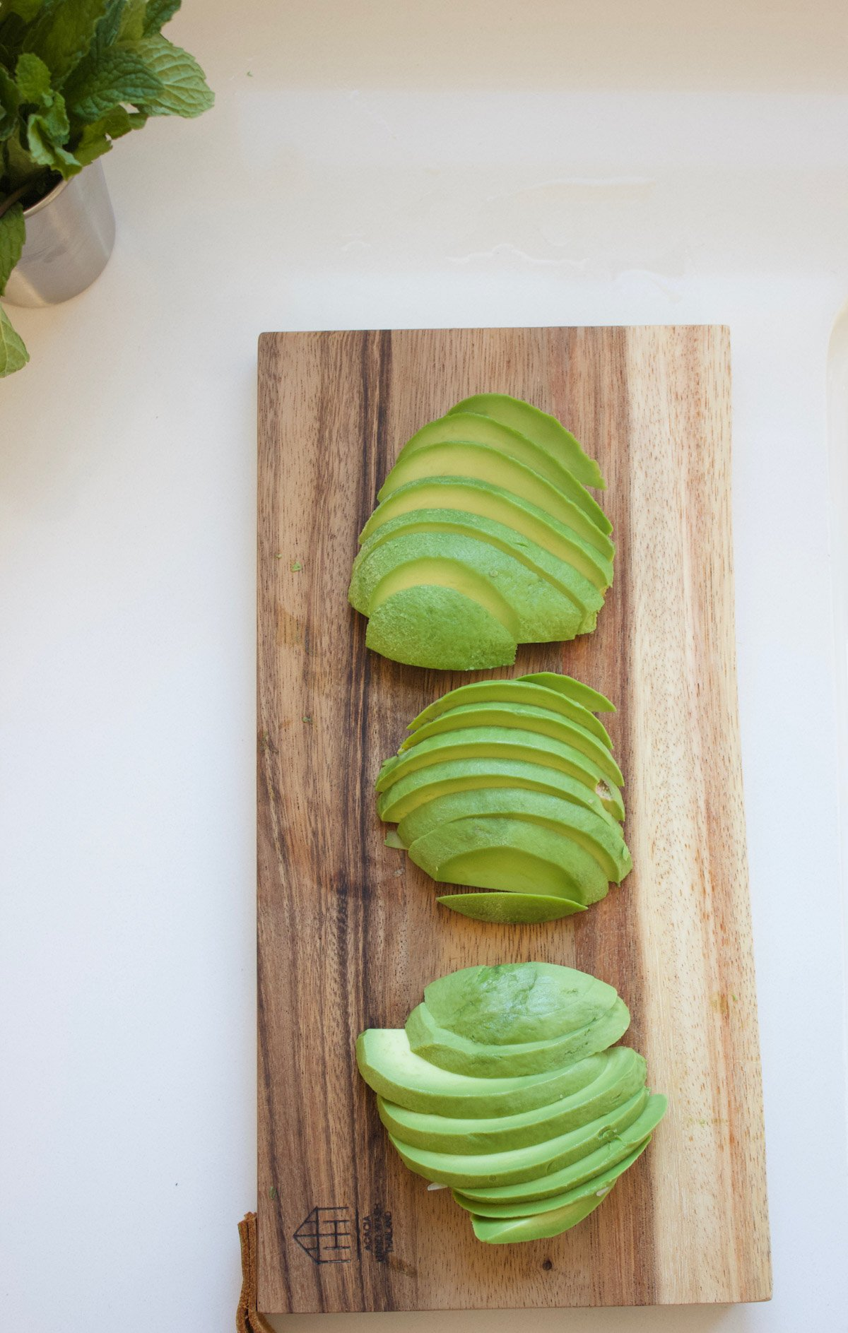 Sliced avocados on a cutting board