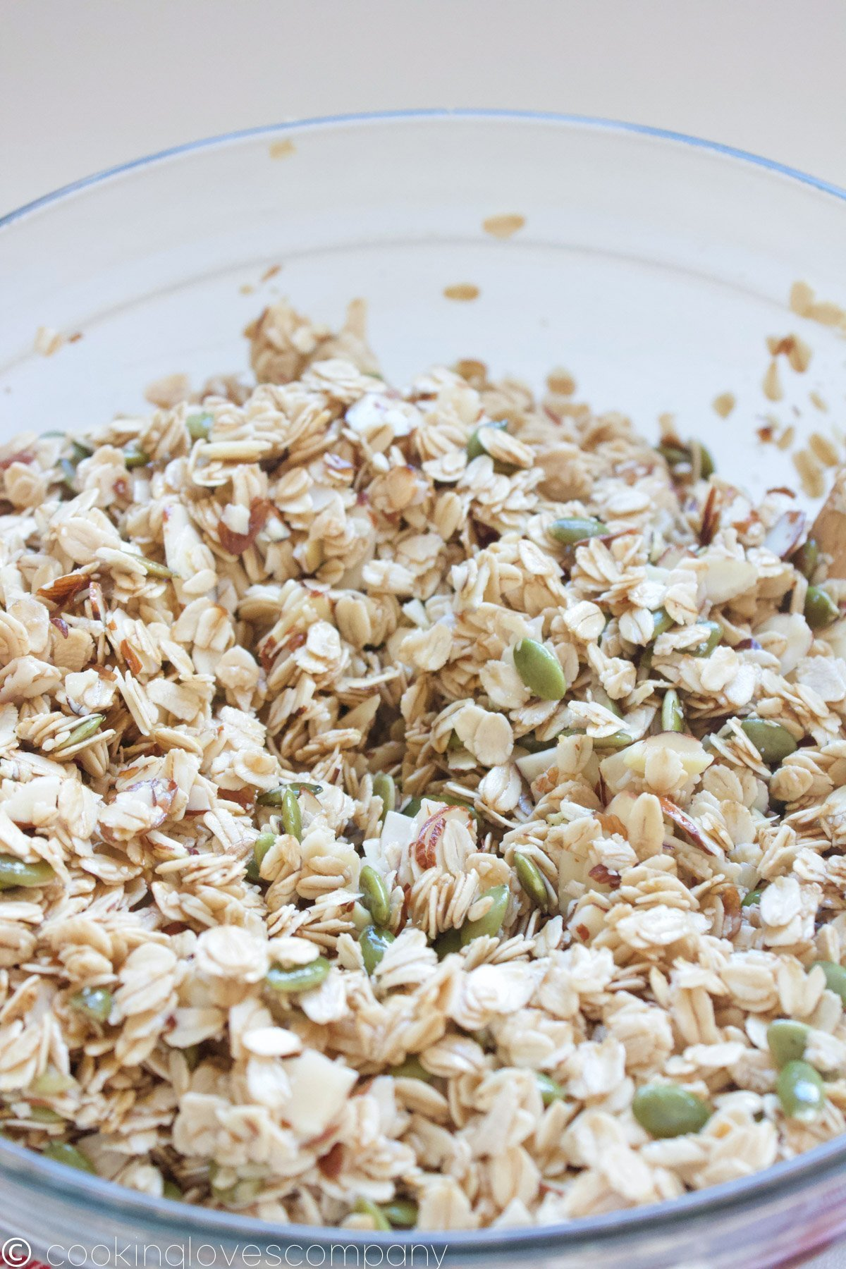 Mixed coconut, maple granola in a glass bowl