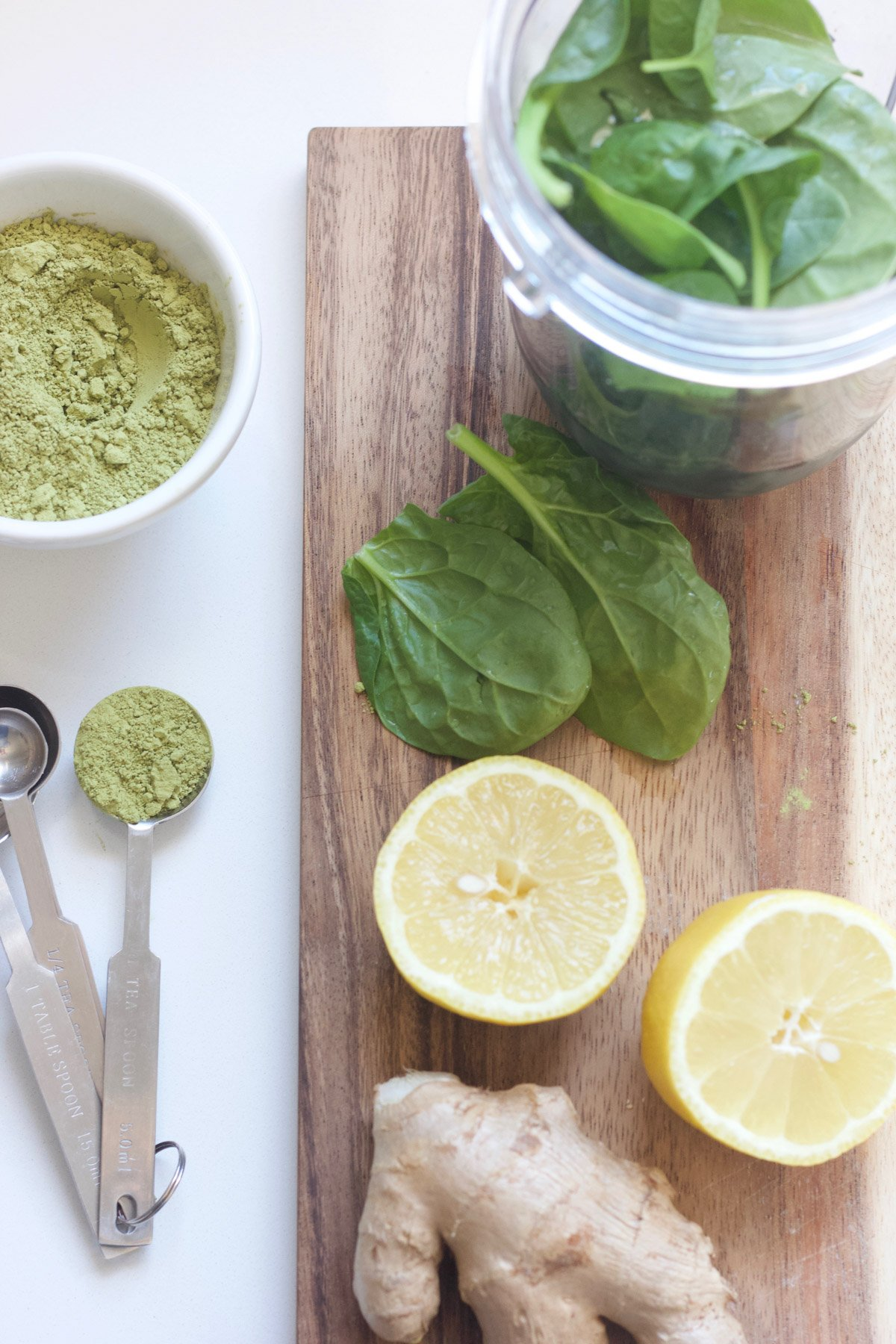 Green smoothie ingredients on a cutting board