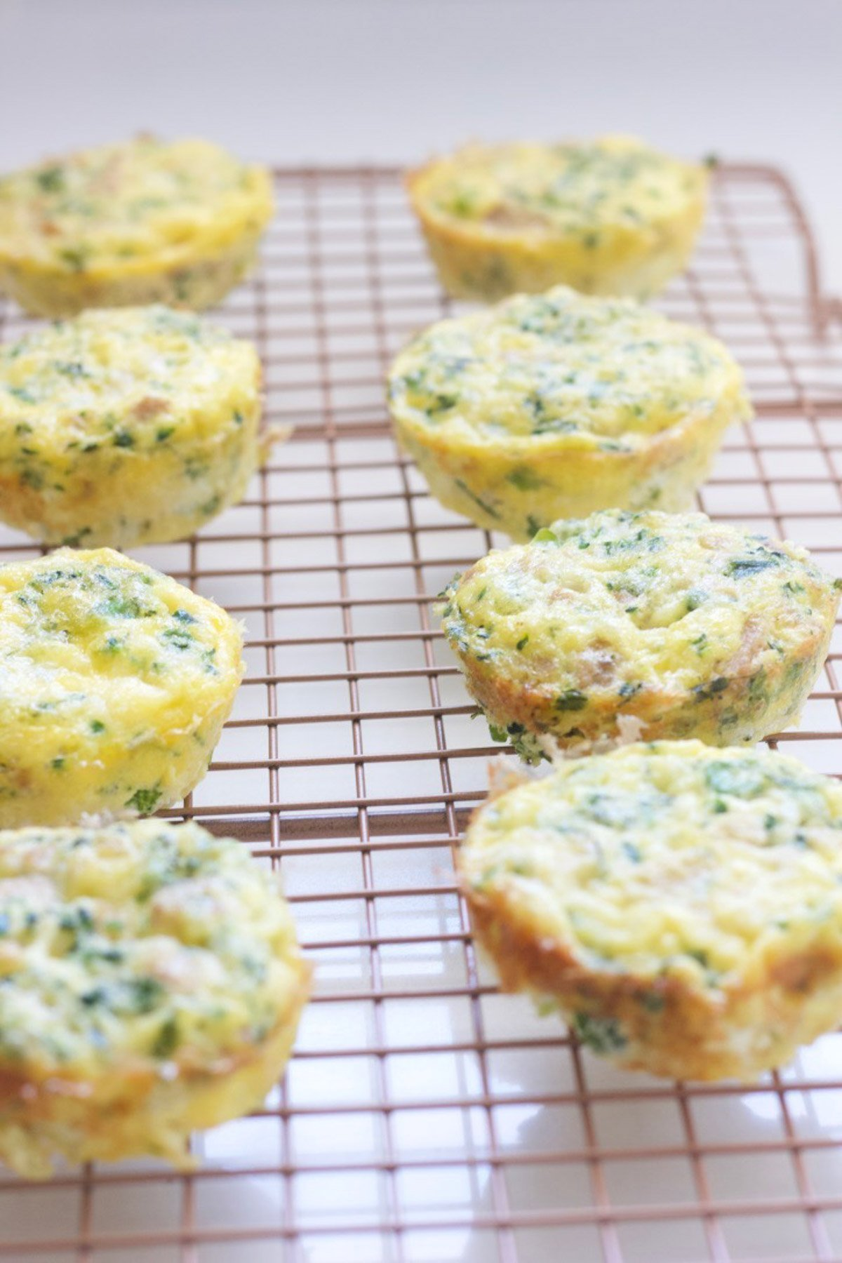 Mini broccoli cheese frittatas  on a cooling rack
