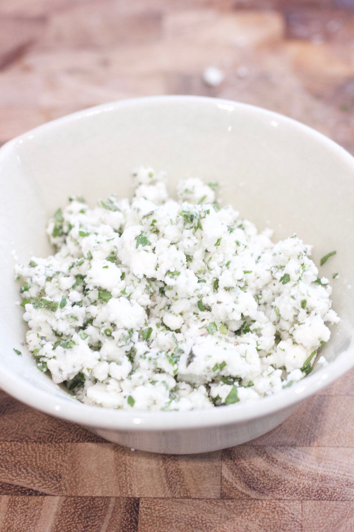 Herbed feta cheese in a bowl