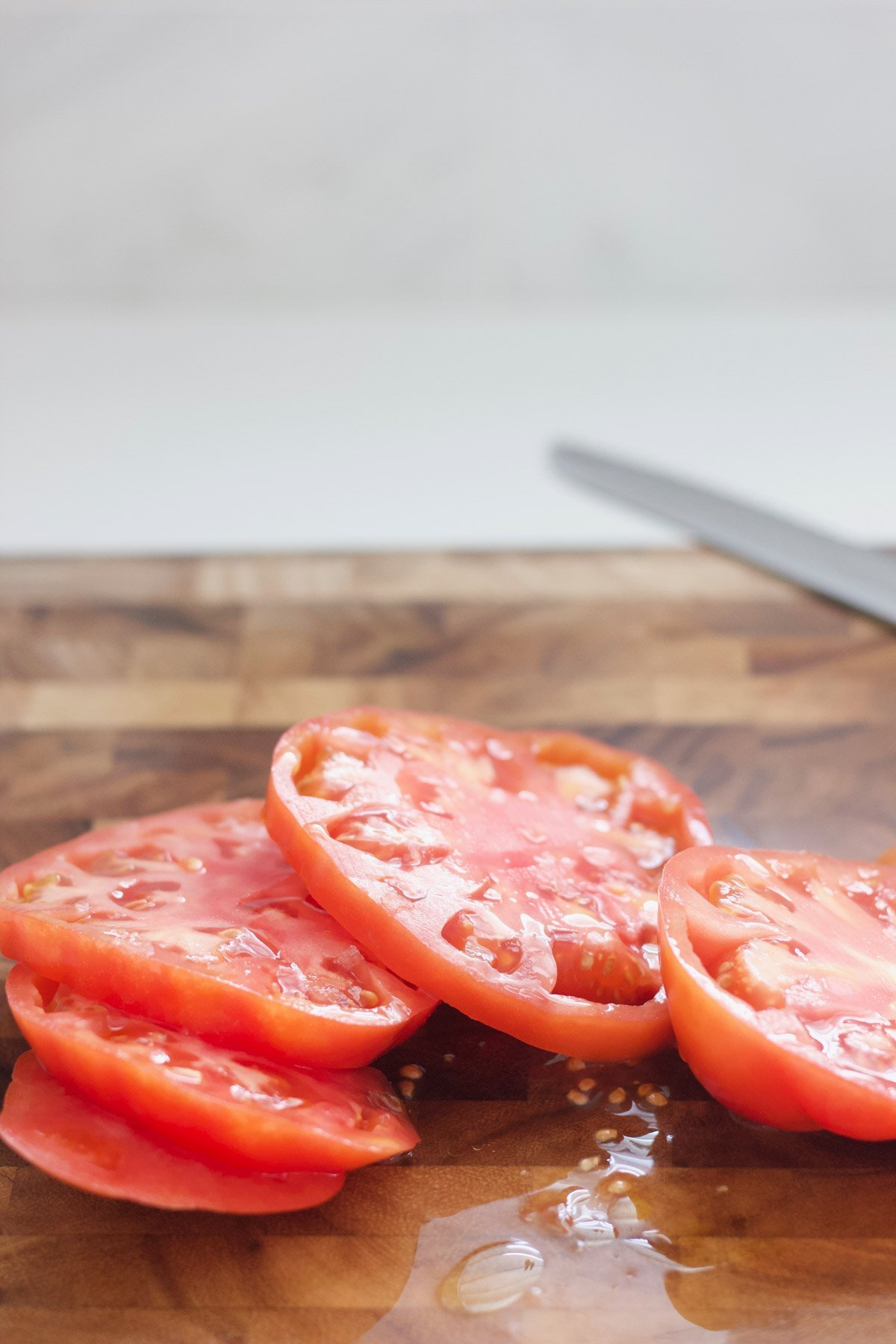 Sliced heirloom tomatoes on a cutting board