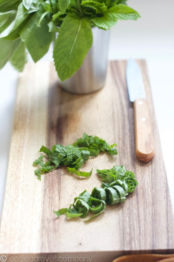 Basil and mint chiffonade on a cutting board