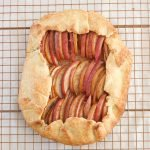 Cooked apple and pear galette on a cooling rack