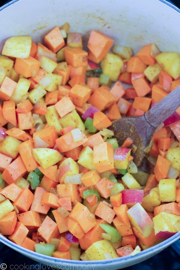 Close up of a dutch oven with diced vegetables