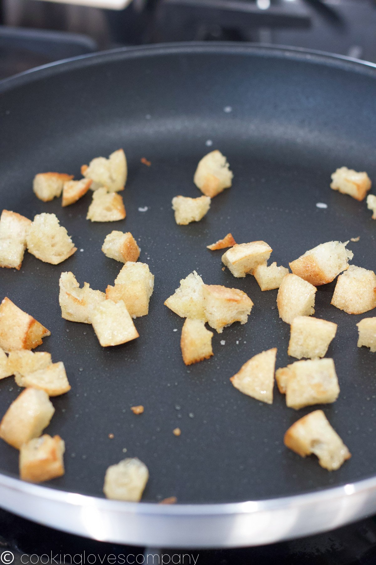 Close up of browned croutons in a skillet