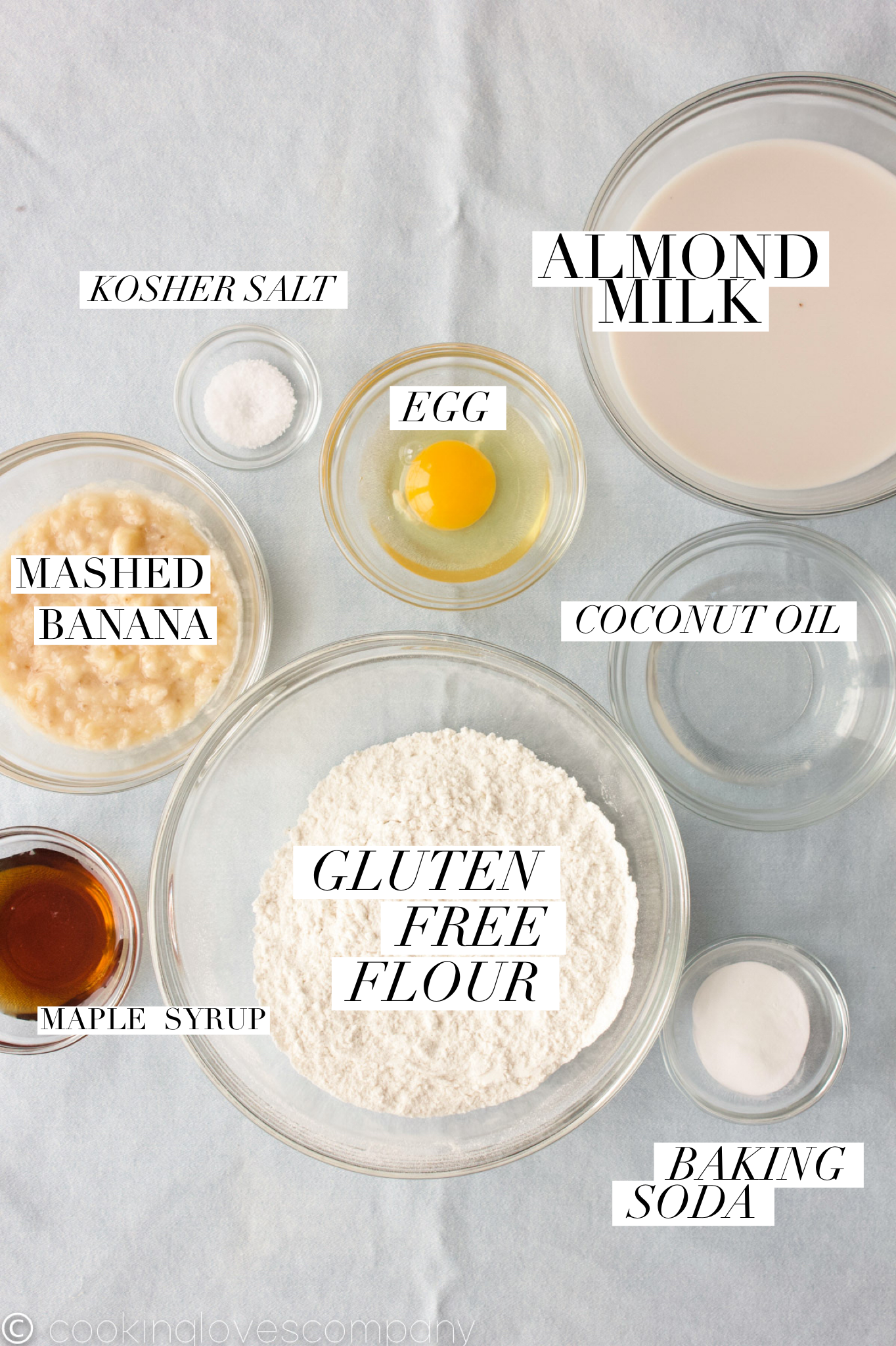 8 glass bowls with individual pancake ingredients in each one