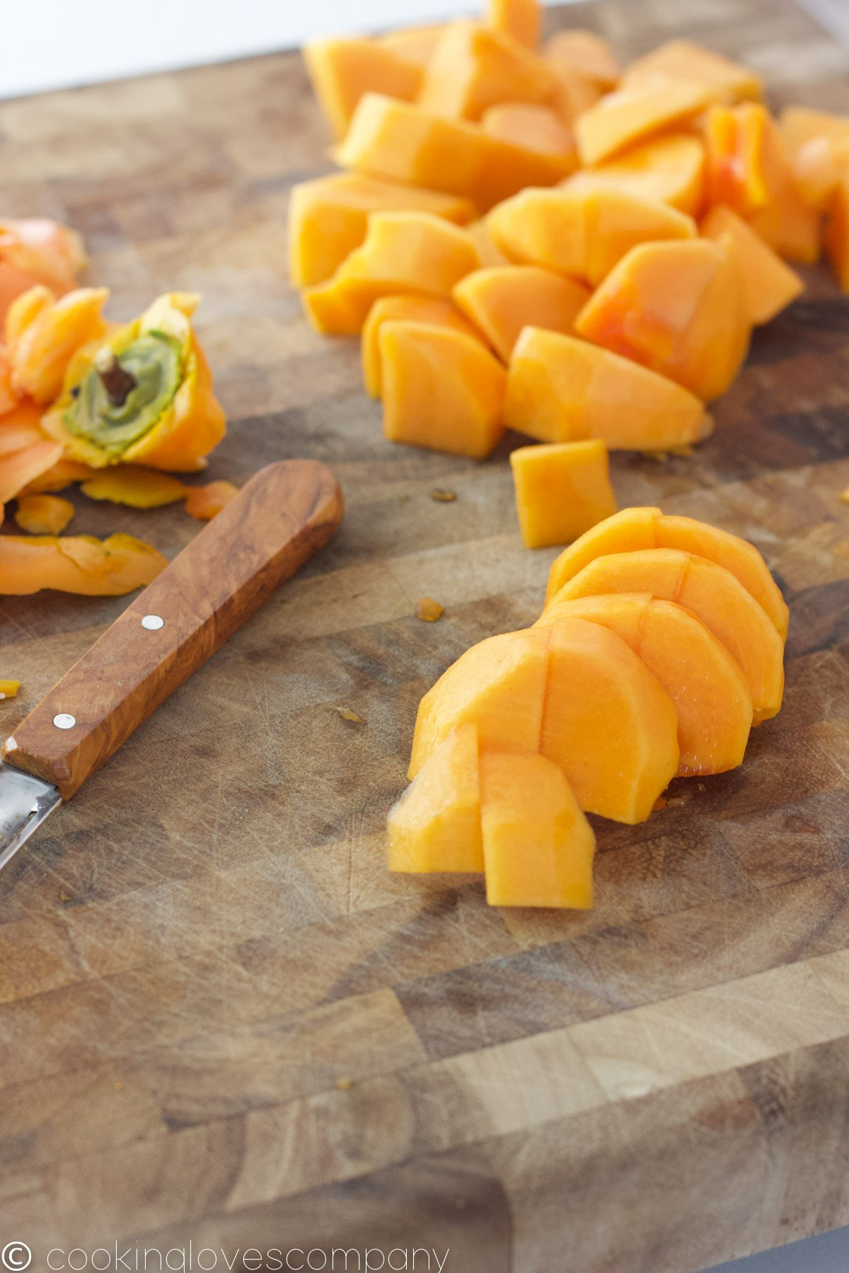 Chopped persimmon on a cutting board